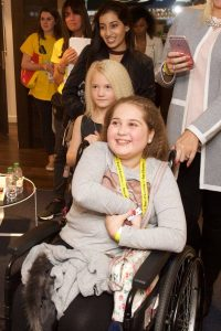 Libby aged 12 photographed in her wheelchair
